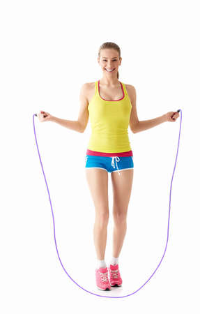 leaping: Young girl jumping rope