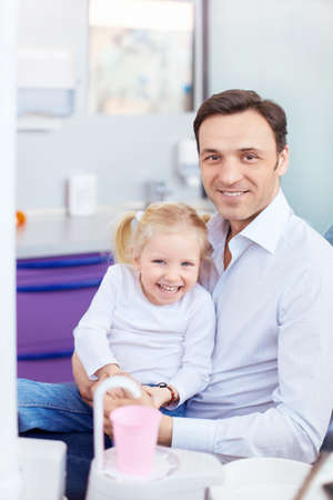 dental clinic: Father and daughter in stomatological room