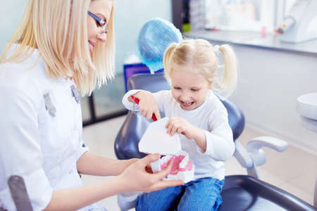 dental chair: Little girl in the dentists office