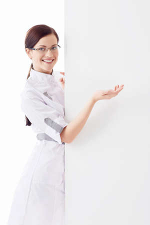 Smiling nurse on white background photo