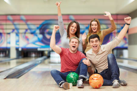 Emotional young people in bowling Stock Photo