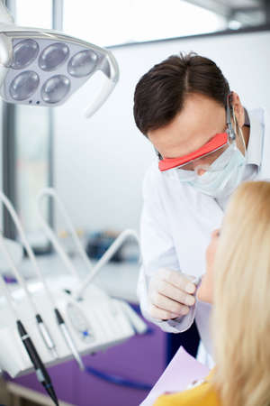 Dentist with patient in office photo