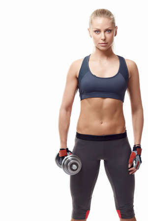 athleticism: Sports girl with dumbbells on a white background