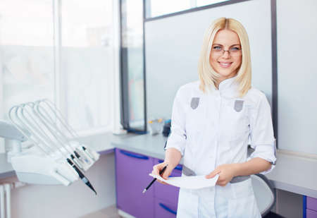 Young doctor in a dental clinic photo