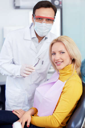 Doctor and patient in a dental clinic photo
