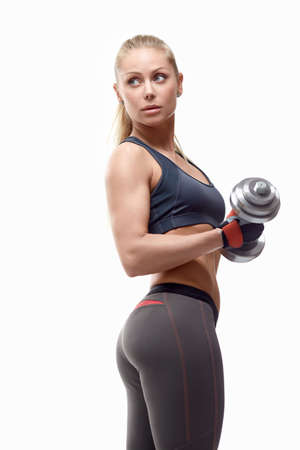 Sports girl with dumbbells on a white background photo