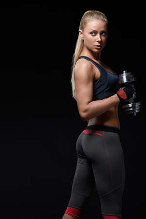athleticism: Sports young woman with dumbbells