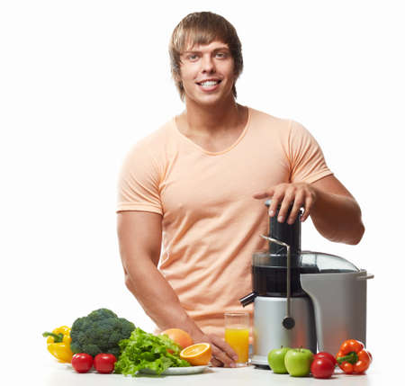 Athletic man with a juicer on a white background photo
