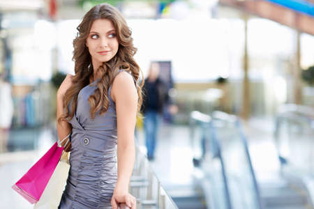 Young attractive girl with bags