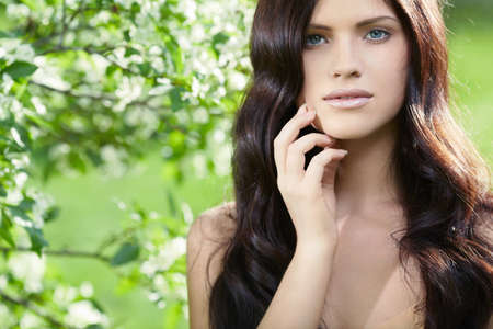 long brown hair: Attractive girl with long hair in park