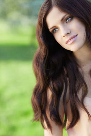 brown hair: Beautiful girl with long hair in park
