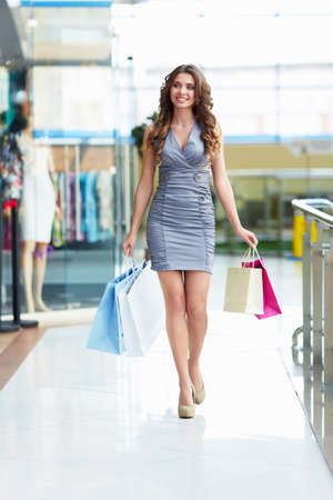 Attractive young girl in a store photo