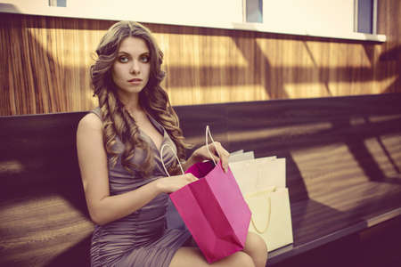 Young girl with bags for shopping Stock Photo - 21946390