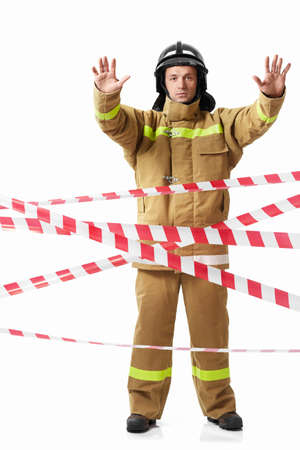Mature fireman in uniform on a white background photo
