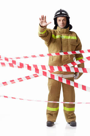 Fireman in uniform with protective tape photo