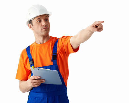 Builder in helmet on a white background photo