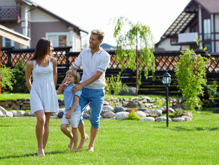 Families with a child on a lawn Stock Photo