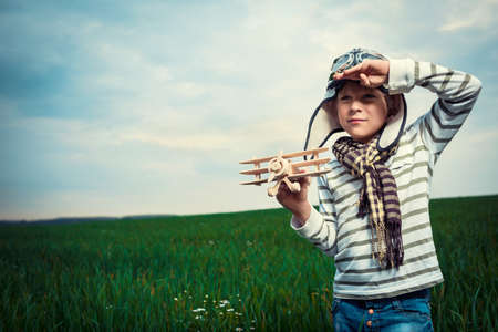 Little boy with wooden plane photo