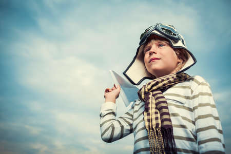Little boy with paper airplane photo