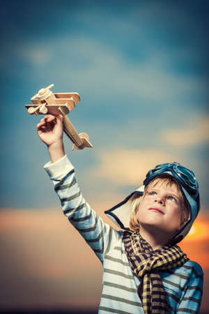 toy plane: Little boy with wooden plane