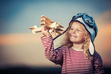 Little girl with wooden plane photo