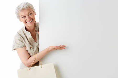 Happy woman with bags on a white background photo