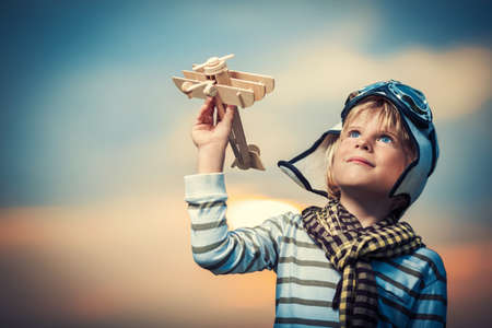 toy plane: Boy with plane at sunset