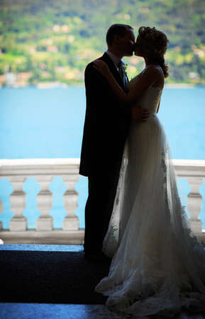 Kissing bride and groom photo