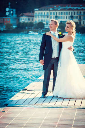 Wedding couple on the quay photo