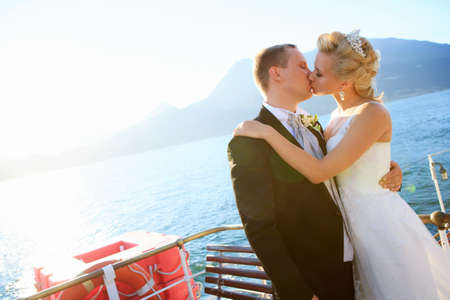 Kissing married couple on the ship photo