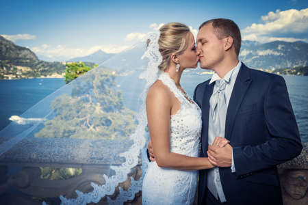 Kissing a married couple in a landscape photo