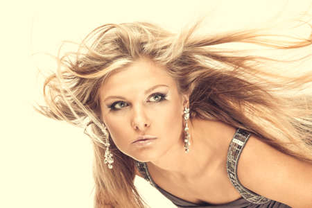 Portrait of beautiful blonde with the flying hair, isolated photo