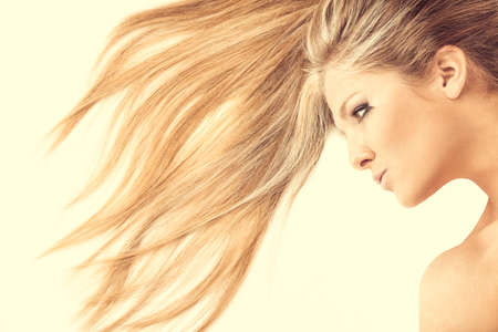 Close up of hair and face of beautiful lying blonde, isolated photo