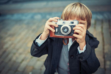 one little boy: Little boy with an old camera Stock Photo