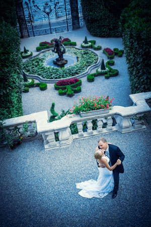 Kissing young couple married in a landscape photo