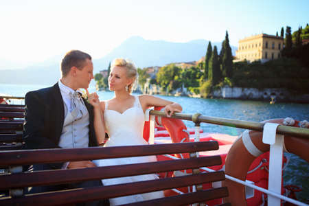 Happy newlyweds on a boat photo