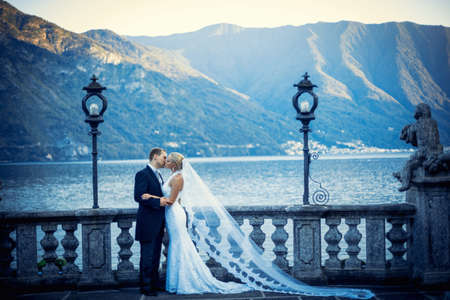 Young newly wed couple in a landscape photo