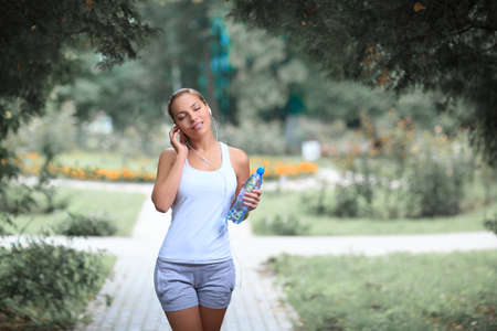 female athlete: Young female athlete in park Stock Photo