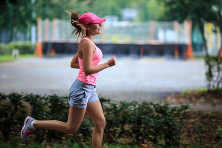jogging in park: Attractive young girl running in park