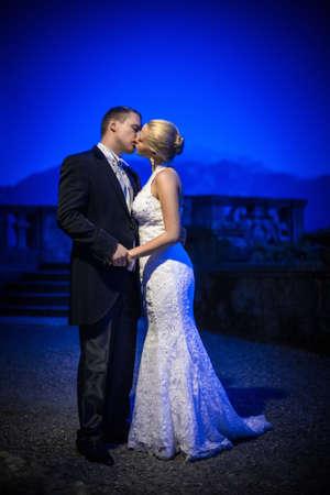 Kissing couple newlyweds outdoors photo