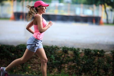 muscular woman: Young girl running in the park