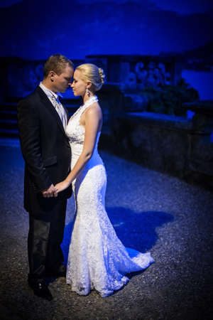 Newly married couple at night photo