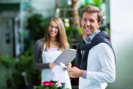 florist shop: Buyer and seller in store Stock Photo
