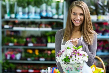 Young florist shop flowers photo