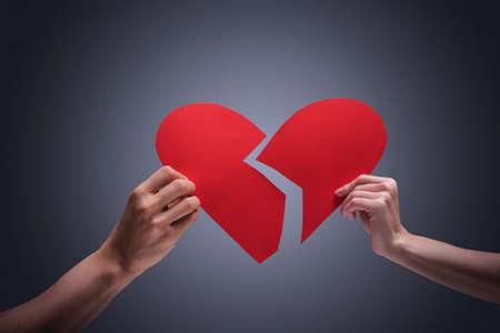 hands holding heart: Hands holding broken heart