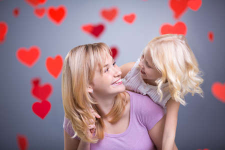 Mother and daughter with hearts in studio Stock Photo - 27081078