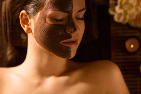 chocolate mask: Young attractive girl in spa salon