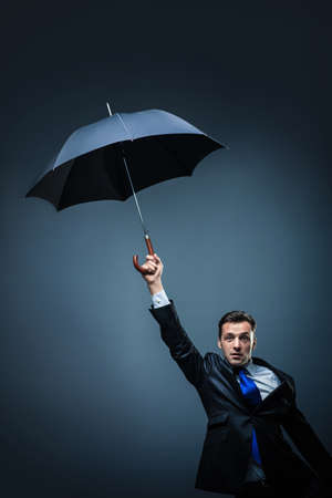 Man in suit with umbrella photo