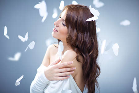 butterfly and women: Young attractive girl with butterflies Stock Photo