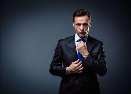 gray suit: Business man in suit in studio